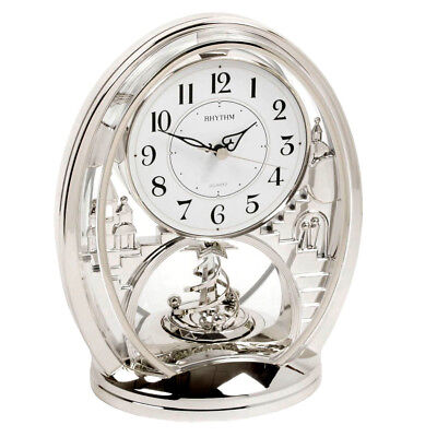 RHYTHM Contemporary Modern Mantel Clock Silver Rotating Spiral Moving Pendulum