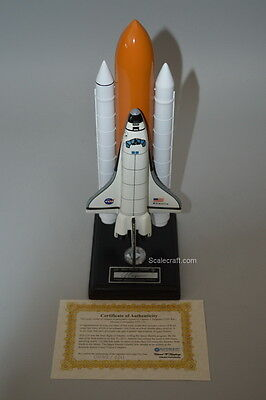 Space Shuttle model signed by last mission commander and piece of actual shuttle