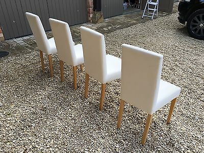 4 x Upright cushioned dining chairs with beech legs. Very comfortable