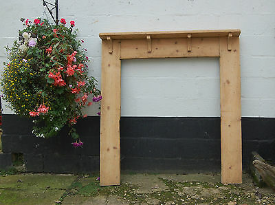 A LARGE GEORGIAN PINE FIRE SURROUND FOR A RANGE ref 498