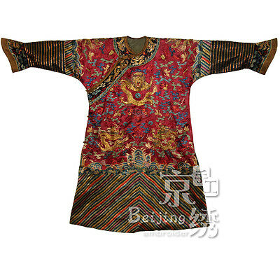 An Important Chinese Qing Dynasty Dark red Ground Dragon Robe/1