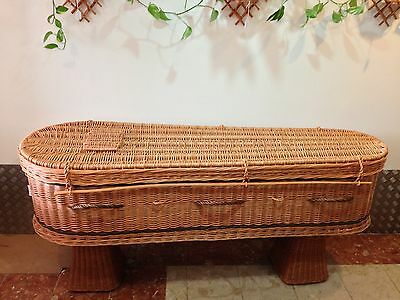 Wicker coffin for cremation on base with plywood