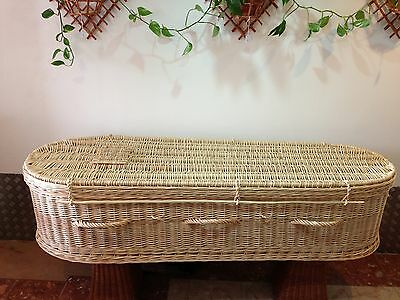 Wicker coffin for cremation with wooden baseboards