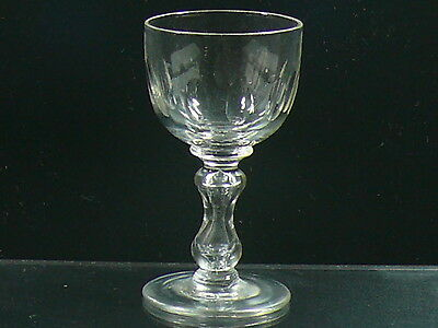 An Antique Mid Victorian Wine Glass With Lens Cuts And Cup Shaped Bowl