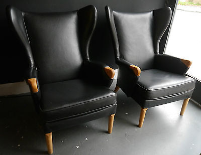 A pair of vintage 1970s reupholstered black leather Parker Knoll armchairs