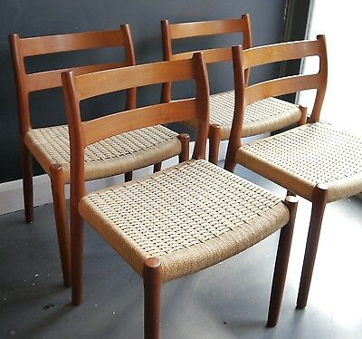 A vintage set of four 1970s Moller 84 dining chairs in teak with papercord seats