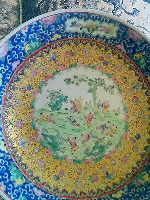 A Vintage Chinese Famille rose dish decorated with Manchu boys.