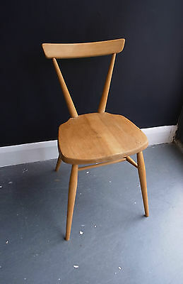 A vintage Ercol adult one bar stacking chair