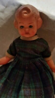 Vintage 1930s celluloid jointed blue sleep eye dressed doll