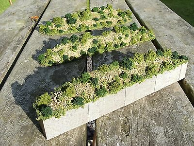 N gauge model railway layout retaining wall and hills background scenery terrain