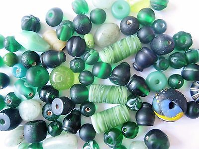 Loose vintage glass beads in shades of green