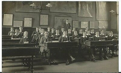 Unidentified location School Children at Desks Geography Lesson ? Maps on Wall
