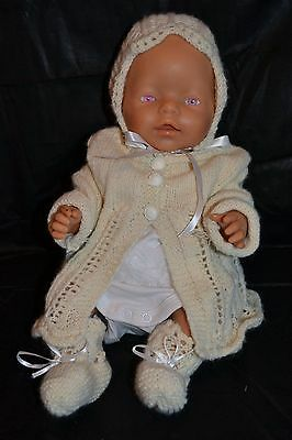 Baby Doll with all new Hand Knitted Clothes.