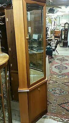 Pair of corner contempory lighted display cabinets in honey colouredwood & glass