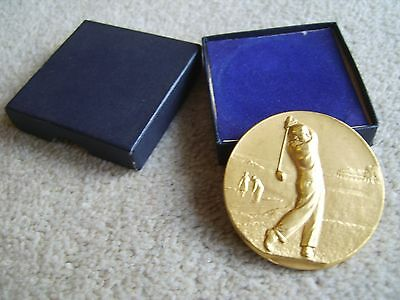 Attractive gold coloured metal Golf medal, no engraving etc & complete with box