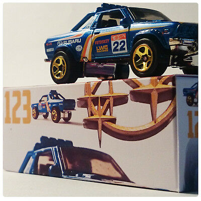 Hot Wheels die-cast #123 SUBARU BRAT aka BRUMBY plus bonus CUSTOM GARAGE BOX
