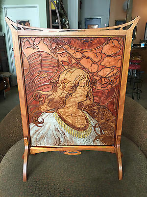 Art Nouveau wood and painted leather fire screen of woman with flowing hair