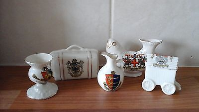 Five pieces of english crested ware,three arcadian