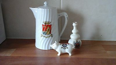 Three pieces of crested ware,torquay pig, tpot scarborough,vase wimbledon