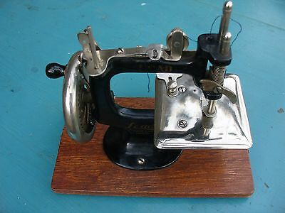 Vintage Small Lead Sewing machine with wooden case