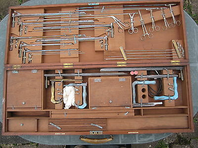 Collection of endoscopes, forceps and other medical paraphernalia in wooden box