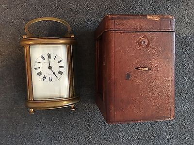 OVAL FRENCH BRASS CARRIAGE CLOCK WEST END WATCH CO. w/Key & Leather Case