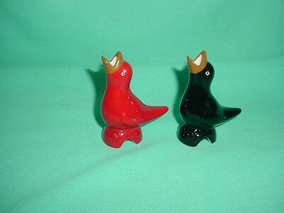 A Pair of Red & Black Bird Pie Vents