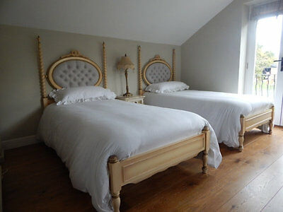 Pair of single  beds with new upholstery