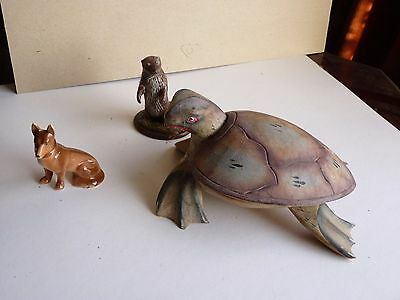 wooden turtle + ceramic alsation + otter by D Gerrard