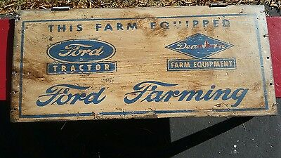 Ford farming  sign painted on old wood. Tractor