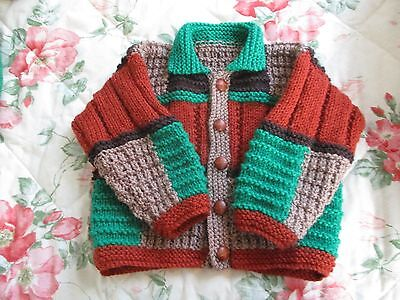 Hand Knitted in Autumn colours Baby/Childrens Jacket 6-12mnths