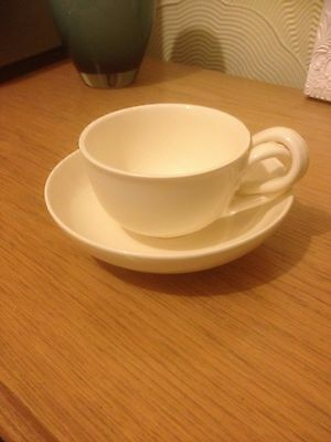 Royal Creamware Cup And Saucer
