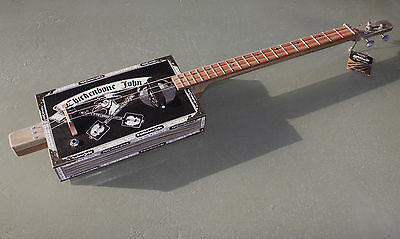 Cigar Box Guitar  by Chickenbone John,  electric 3 string - Plague Doctor
