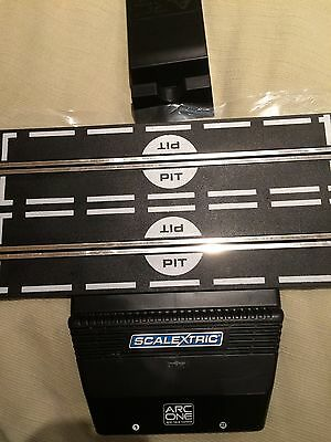 Scalextric Arc One powerbase, two controllers, and transformer