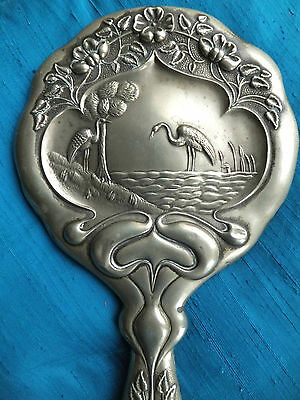 art noveau style hand mirror silver colour metal frame birds flowers decorative