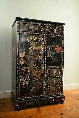 Chinese lacquered cabinet with peony and peacock design.
