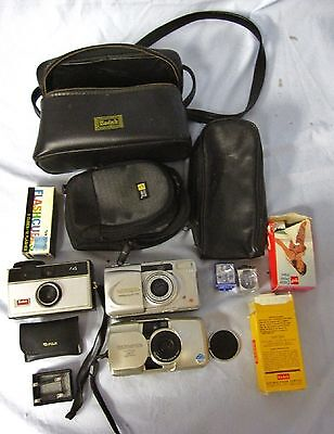 3 Vintage Film Cameras With Film, Flash Cubes And Cases