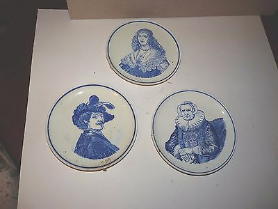 3 delft wall plaques showiing people