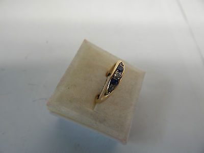 Hallmarked 18 CT Gold Ring with Diamond and Sapphires Size M1/2.