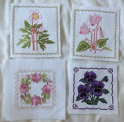 Completed 4 X floral cross stitches
