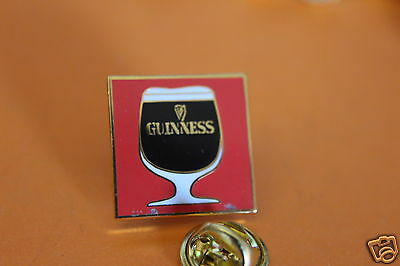 GUINNESS glass of red  TIE OR LAPEL pin badge.