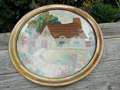 Vintage hand embroidered picture of thatched cottage and country garden, framed.