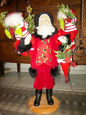 "Lynn Haney Signed ""Holding on for christmas"" 27inch Santa 2009 style#38809"