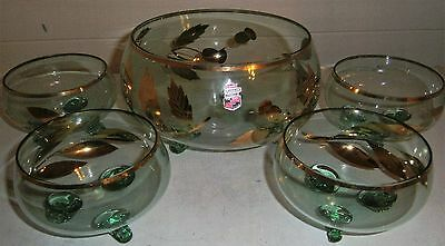 set of bohemian glass desert bowls with larger bowl