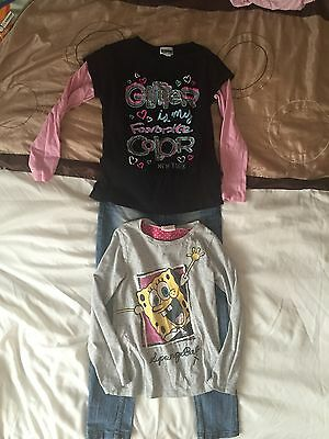 2x Girls Long Sleeve T-Shirts and 1 X Jeans with belt. Age 7-8 years.