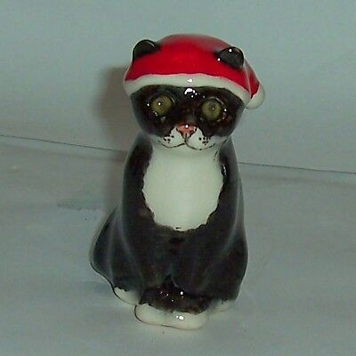 Winstanley Size E Black and White Cat sittiing wearing Christmas hat