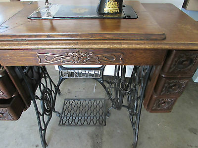 Antique Singer Sewing Machine With Cast Iron Treadle  Base Tiger Oak Cabinet