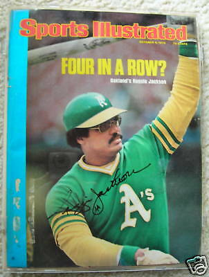 1975 SI signed by Reggie Jackson