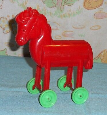 vintage Christmas plastic RED HORSE ON WHEELS candy holder container