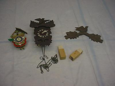 Pair of German-Made Novelty Black Forest Cuckoo CooCoo Clock Brass Movement E140